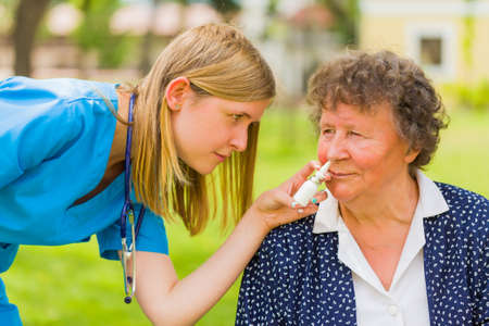 Medical service for pensioner woman with allergic disease. Stock Photo
