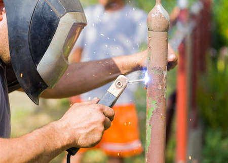 sparking: Closeup of sparking diy job with flex by handyman on gate lath.