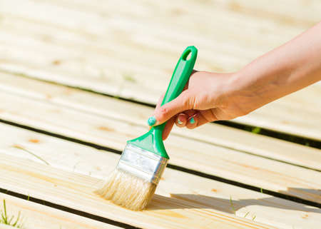 treated board: Renovation of spring by  applying waterproof dye with paintbrush.