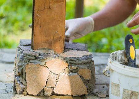 wainscot: Man hand working outdoors to obtain stylish wainscot. Stock Photo