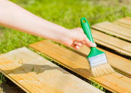 lasting: Protection of mordant by applying varnish on it to obtain it long lasting. Stock Photo