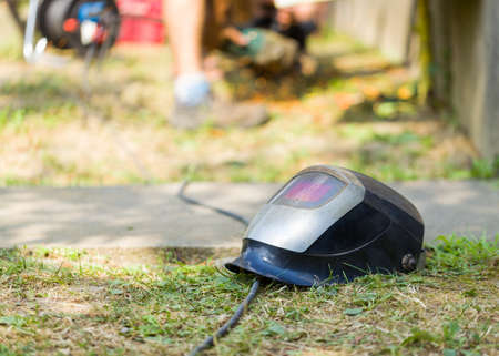 industry architecture: Close up of prepared work helmet on the ground for safety. Stock Photo