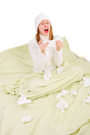 Young girl staying in bed, suffering from influenza and sneezing