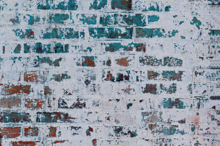 Gray background old plastered brick wall with elements of blue paint