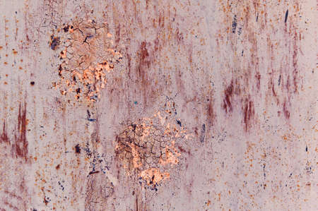 Old painted sheet of metal with cracked paint and rust gray beige peach terracotta blue pink Stok Fotoğraf
