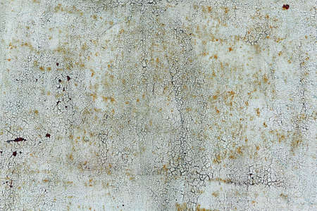 Old cracked white coat of paint background with leaky rust. Stok Fotoğraf - 145682239