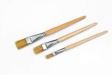 three art brushes made of natural bristles of different sizes on a white background.equipment for the painter Stok Fotoğraf - 145492328