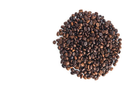coffee beans, lie in the shape of a circle on a white background, top view. Stok Fotoğraf