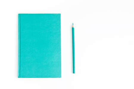 Notebook daily planner and pencil same turquoise color on a white background Stok Fotoğraf - 147518804