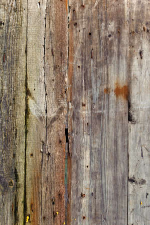 antique background old dilapidated fence of planks with nails and cracks