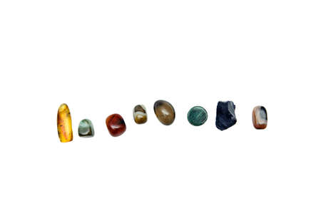 various semiprecious stones on a white background, from above, isolate