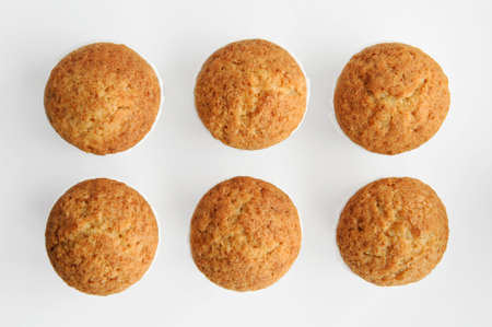 cupcakes on a white background, arranged in two rows, isolated, shot from above.