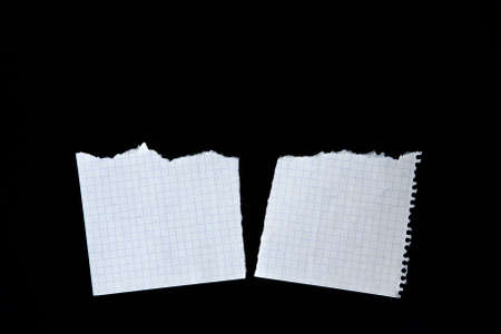 Two sheets of notebook. Torn paper on black background Stok Fotoğraf - 151907519