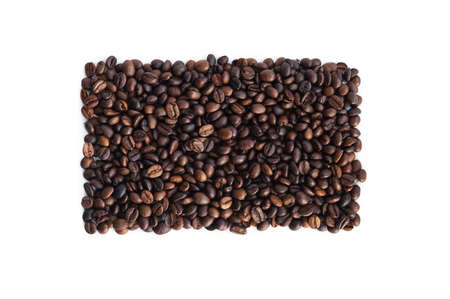 coffee beans lie in the shape of a rectangle on a white background, top view