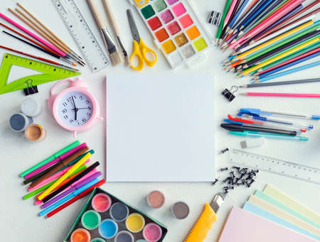 Flatley: school supplies laid out around a blank sheet