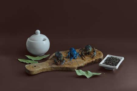 river blue crayfish fresh on kitchen board on brown background
