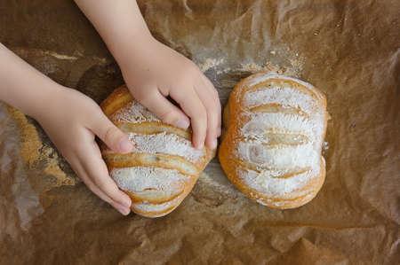 homemade hot flavored sourdough wheat bread,baby hands Stok Fotoğraf