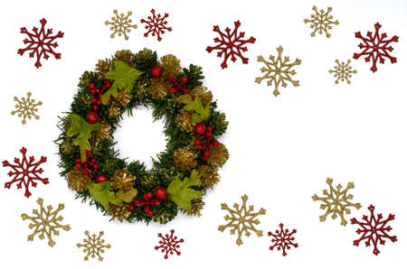 Colorful Christmas wreath with red and gold snow flake ornament isolated on white background with space for text.