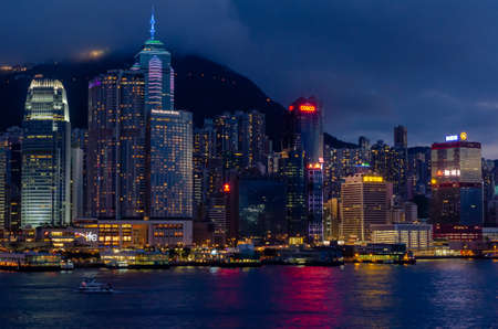Night time beautiful scenery skyline of Hong Kong city from Tsim Sha Tsui area face to Central area with many high buildings and sea view. Editorial