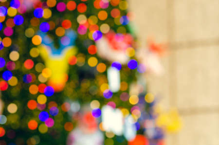 Blurred focus of colorful Christmas tree for Holiday decoration background.