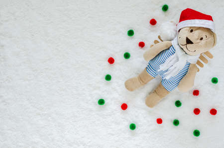 Smilling Santa Teddy bear with snow on the ground for Christmas background concept.