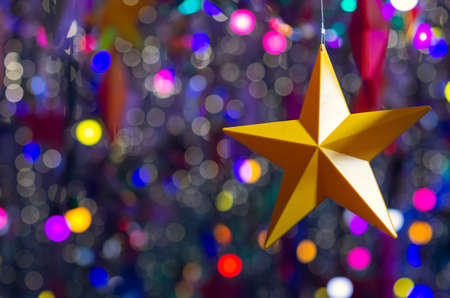 Colorful star ornaments hanging to decorate for Christmas holiday.