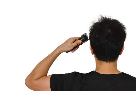 Man cutting his own messy hair with a clipper when quarantine time isolated on white background for stay home concept.