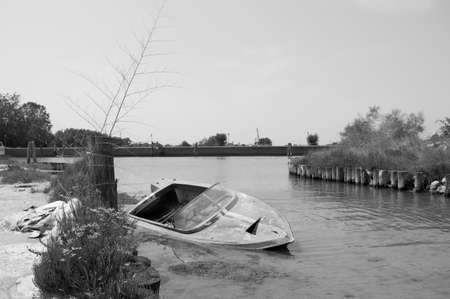 Abandoned boat in the lagoon of Venice