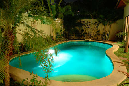 Night swimming pool in tropical garden Stock Photo - 5488201