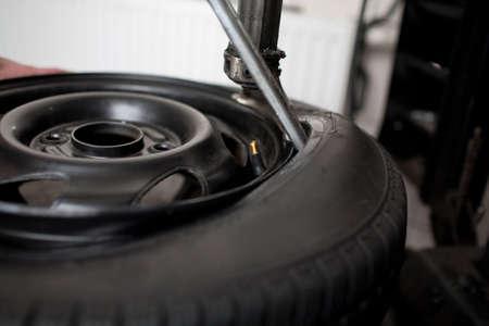 Mechanic changing a car tire closeup