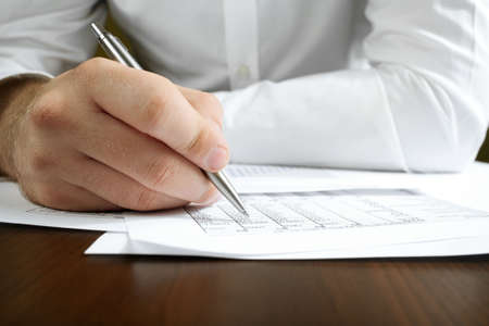 Financial data analyzing. Counting business data on the table Stock Photo