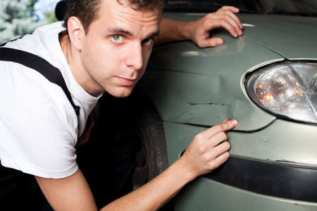 Close-up of damaged car  inspected by mechanic Stock Photo - 5625885