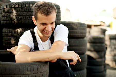 Young mechanic laughing outside car service Stock Photo - 5625875