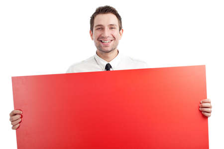 Young Businessman holding red blank sign and smiling isolated on white. You can add your idea on the sign. photo