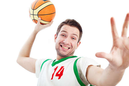 Close up of young basketball player who is dunking. Isolated on white. Stock Photo