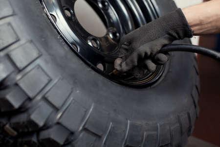 Mechanic repairing wheel. Stock Photo - 10387785