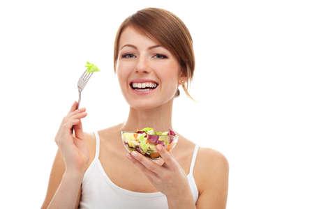 分離されたフォークのサラダ ダイエット女性の笑みを浮かべて