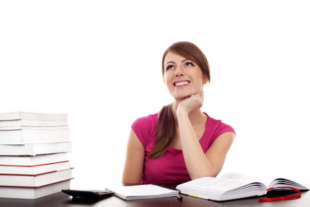 Female student sitting behind the desk learning