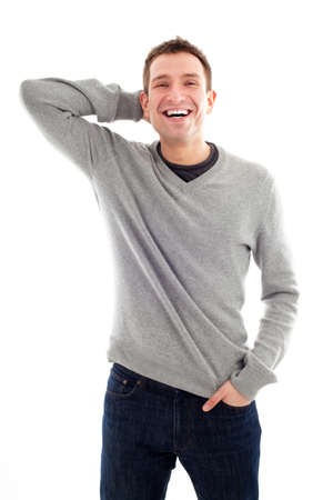 hand in pocket: Happy handsome man standing isolated Stock Photo