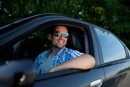 own: Handsome man smiling in his own car