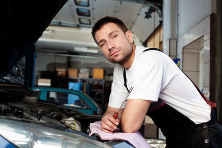 handsome car mechanic in auto repair shop Stock Photo