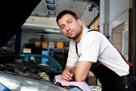 handsome car mechanic in auto repair shop Stock Photo