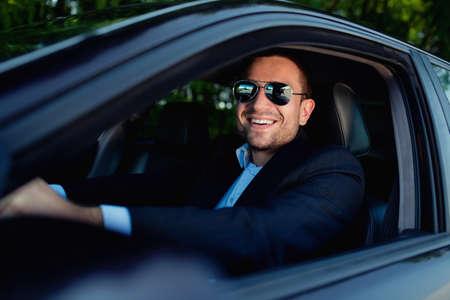 businessman in car smiling Archivio Fotografico