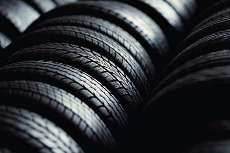 align: Tire stack background. Selective focus. Stock Photo