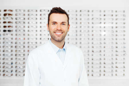 optician: Optometrist, optician or eye doctor standing in store