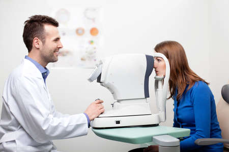 eye exam: Woman getting visual field test done by the optometrist