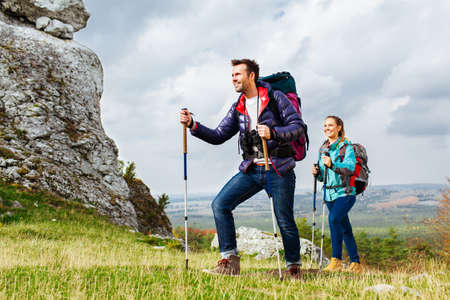 Backpackers hiking. Two young tourists on the trial Stock Photo