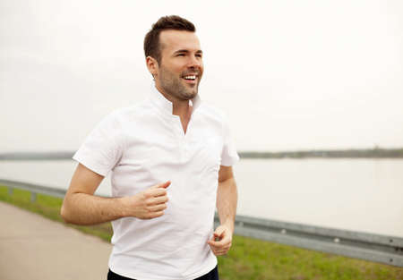 hansome: Happy hansome man running