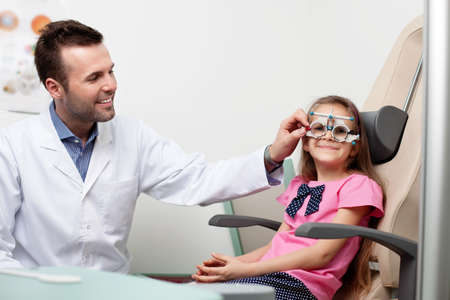 medical attendance: Optometrist examines the sight of young girl