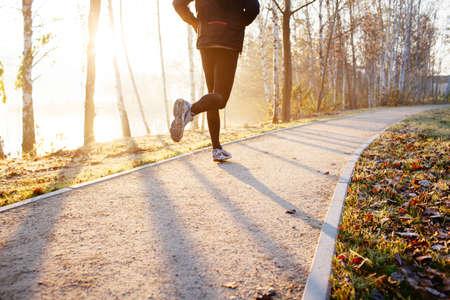 solitude: Man running at autumn during sunrise